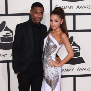 Singer Ariana Grande and rapper boyfriend Big Sean show lots of affection for each other and kiss and embrace on the red carpet at the 57th annual Grammy Awards