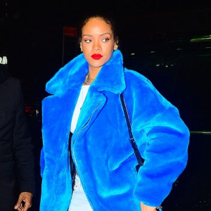 Rihanna looks stunning in a blue jacket in Times Square