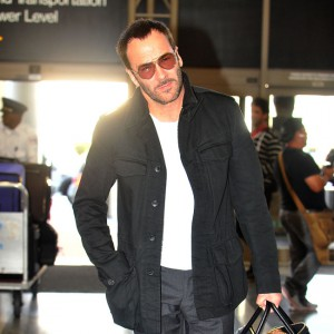Tom Ford and his husband Richard Buckley head through LAX with their son Alexander