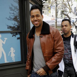 Romeo Santos stops to chat with Mario Lopez on Extra at The Grove in Los Angeles, California